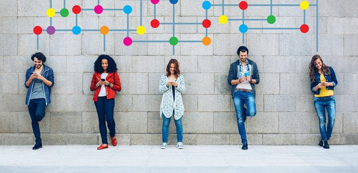 five people texting at urban scene.